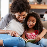Mom reading to her child with type 1 diabetes